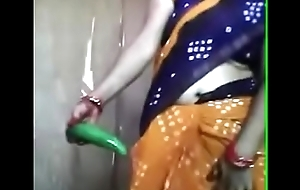 Desi aunty effectuation with cucumber