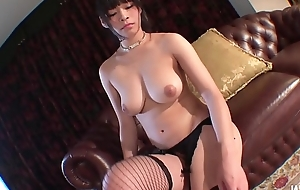 Presents her assets in a nude solo show