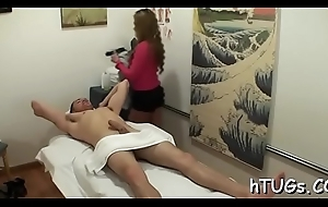 Hot chick rubs a client and ends up playing with his cock